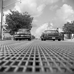 (patrickjoust) Tags: auto street city urban bw usa white black 120 6x6 tlr blancoynegro film home car festival analog america square lens grate grid us reflex md focus automobile fuji mechanical pennsylvania united north patrick twin maryland super baltimore cadillac parade 150 v homecoming epson fujifilm medium format neopan 100 states manual 500 rodinal avenue 80 joust developed develop acros estados 80mm f35 blancetnoir unidos yashinon ricohflex v500 schwarzundweiss autaut patrickjoust