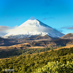 Mount Ngauruhoe, New Zealand (Ed Kruger) Tags: travel blue winter newzealand sky sun mountain snow clouds forest landscape volcano bush wildlife sunny hills adventure nz northisland kiwi volcanic aotearoa allrightsreserved active vocation admiralty skyphoto mountngauruhoe newzealandphoto edkruger photoofnewzealand abaconda qfse photosofthesky
