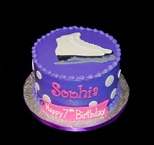 purple  and white polka dot ice skating birthday cake