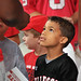 A player with the North Raleigh Bulldogs looks up to a Wolfpack player as he waits for an autograph.