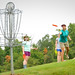 Sisters of the Alpha Omega Epsilon sorority play in a tournament on the disc golf course on Centennial Campus.