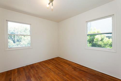 8 - bedroom with hardwood flooring