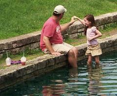 Summer Dance (Renee Rendler-Kaplan) Tags: summer people water girl childhood smiling reflections him happy pond sitting child gbrearview dancing kodak saturday august starbucks sit there littlegirl summertime them kodakeasyshare he evanston seated carefree gapersblock summerdance wbez purpleshoes chicagoist beesknees beherenow shallowwater 2011 cargoshorts evanstonillinois twodrinks dawespark watchher malibutshirt reneerendlerkaplan thebandbegantoplay thegirlbegantoswirl childhoodissofleeting sharethedance