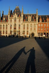 Love in Bruges 1 (amos lee) Tags: travel family building love silhouette architecture couple europe gothic brugge warmth grand cobblestones belguim bruges holdinghands oldtown medival townsquare marketsquare provincialcourt