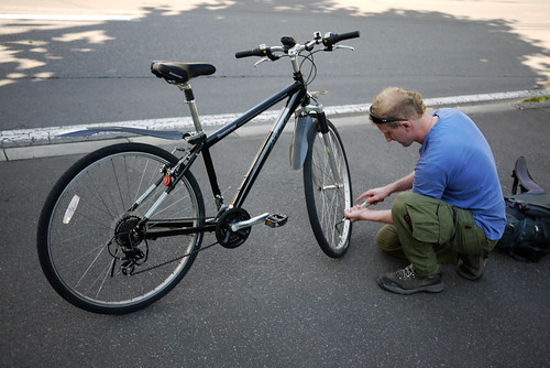 Couchsurfer Cezary putting together his secondhand bike in Sapporo, Japan