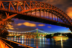 Summer Night (Moniza*) Tags: city nyc longexposure bridge ny newyork reflection skyline night skyscraper nikon downtown cityscape searchthebest manhattan illumination midtown explore queens eastriver astoria gothamist bluehour astoriapark gothamcity triborobridge hellgatebridge thebigapple triboroughbridge d90 explored moniza robertfkennedybridge photographerschoice~halloffame