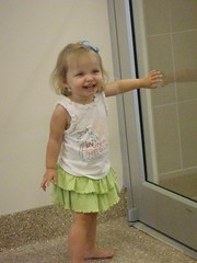 Watching Vivianne's swim lesson through the glass door