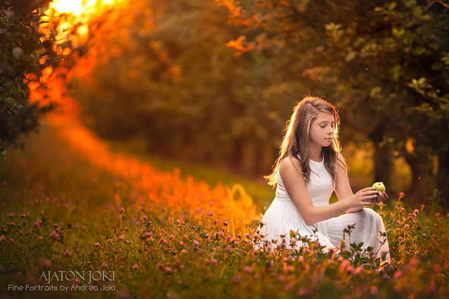 young girl at the apple orchard