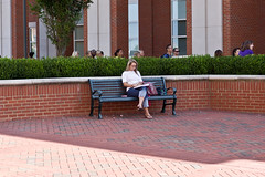 DSC04299_1 (DriveByShutter) Tags: woman wall bench campus candid crowd hedge blonde isolated separate