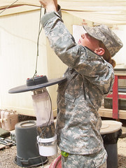 Soldier hangs an insect trap. (United States Forces - Iraq (Inactive)) Tags: rose iraq july calif mich medicine flint blackjack specialist santaanna 1stcavalrydivision luengas preventative 2ndbrigadecombatteam operationnewdawn usdivisionnorth 2ndadviseandassistbrigade cobwarhorse 15thbsb