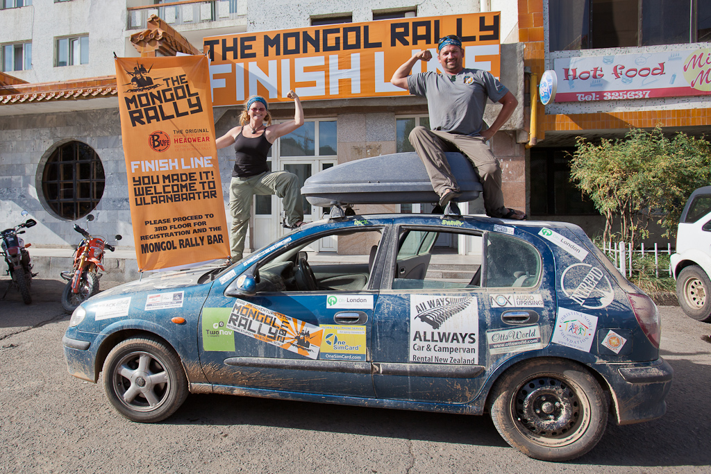 car covered in sponsors for mongol rally
