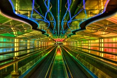 ORD (Thad Roan - Bridgepix) Tags: chicago lights vanishingpoint illinois airport neon tunnel terminal symmetry ohare walkway passenger ord lightshow ual concourse unitedairlines 201108