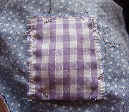 pouch pinned to back of bird square