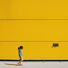 Little Miss Sunshine (. Jianwei .) Tags: street blue light shadow color ikea girl smile sunshine yellow wall vancouver kid emily mood geometry walk sony pipe sigma streetlife minimal line yang burnaby coquitlam 365 simple 1735mm loug