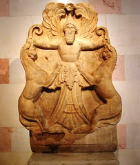 Arimaspian or a winged-deity holding griffins by their horns (nox-AM-ruit) Tags: horn hermitage griffin deity
