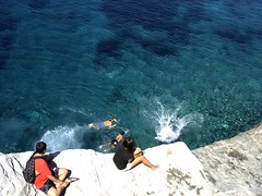 The dip in the gap, diving into the sea (dimitra_milaiou) Tags: blue boy sea summer people color castle water girl island greek happy europe colours child time sony joy hellas happiness diving visit greece hora teenager chora andros cyclades exciting trasparent dimitra hellenic  dscp93a          milaiou