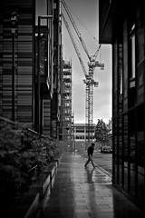 Edinburgh....rushing to work (martin.mutch) Tags: white black building wet rain edinburgh crane damp