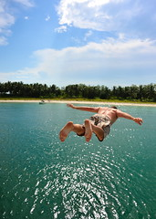 Taking a flier (jeremyhughes) Tags: sea man feet beach water swimming flying jump jumping nikon singapore flight dive levitation diving explore barefoot jumper diver 20mm suspended trunks bathing nikkor leap leaping flier d700 takingaflier