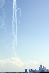 Bigger (colinhenningphotography) Tags: show life city blue summer sky sun chicago water lines vertical architecture outdoors movement bright vibrant smoke awesome airplanes perspective lakemichigan airshow simple tone