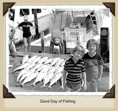 Rob & Jon (robert (Bobby)powell) Tags: family blackandwhite fish tampa fishing jonathan rob fl scannedphoto pinellascounty clearwaterbeachfl flickraward nikonnikkormat robjon flickraward5 robertbobbypowell