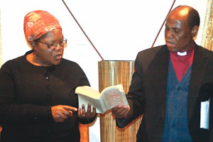 Vice President Joice Mujuru and Bishop Eben Kanukai Nhiwatiwa of the United Methodist Church sing a hymn at her Chisipite home in Harare yesterday. by Pan-African News Wire File Photos