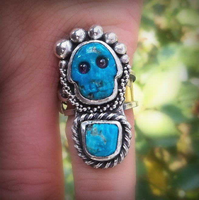 Ring of Mictecacihuatl, day of the dead sterling silver and turquoise. Is made of hand carved Kingman blue turquoise and two red garnets