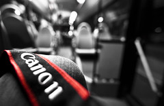 Alone in the bus [Explored] (Issa Fakhro) Tags: camera red blackandwhite bw bus art colors night canon photography photo europe flickr traffic sweden bokeh dslr publictransport malm selective blackandwhitephotography artisticphotography 1635mm wideanglelense sknetrafiken