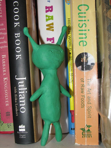 Alien at the Book Pile