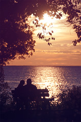 sweet summertime ... with autumn closing in (pixelmama) Tags: sunset summer love silhouette wisconsin clouds bench couple bokeh greenbay  nightmoves fishcreek peninsulastatepark bobseger chasinglight lakemichigancircletour workinonournightmovesinthesummertime inthesweetsummertime withautumnclosingin