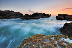 Ocean (Nora Carol) Tags: sunset bali nature indonesia moss wave angler colorsofthesea mengeningbeach