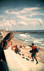 Peeking away (O9k) Tags: ocean sea woman film beach analog 35mm coast xpro xprocess kodak bokeh crossprocess rangefinder shore analogue peeking sitges lookingaway canon7s selfdeveloped c41 095 homedeveloping dreamlens motionpicturefilm ecn2 intermediatefilm so443