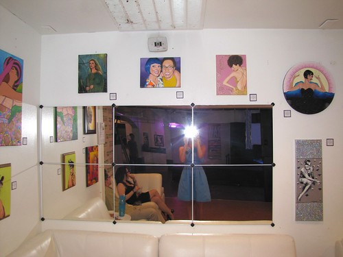paintings over the mirror