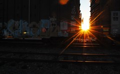 Sunrise over the tracks (brian's other photo page) Tags: sunrise traintracks sunflare traincars addisontx northdallas