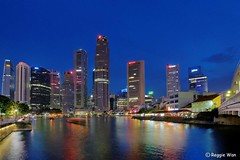 The CBD of Singapore. (Reggie Wan) Tags: city skyline architecture evening singapore asia southeastasia cityscape cbd bluehour boatquay singaporeriver moderncity asiancity sonya700 sonyalpha700 reggiewan gettyimagessingaporeq1