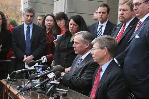 Attorney General Abbott and other attorneys general voice their opposition to the health care mandate outside the Federal Courthouse in Pensacola, FL