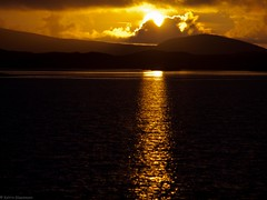 Sunset (katrin glaesmann) Tags: sunset sea sun holiday mountains reflection mirror scotland meer sonnenuntergang hills outerhebrides 2011 northuist locheport userehebriden