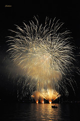 Fireworks - Laveno - Lago Maggiore - 15 Agosto 2011 (G.hostbuster) Tags: light people lake silhouette night reflections dark boat barca gente fireworks freehand riflessi notte luce assumption lagomaggiore buio ghostbuster fuochidartificio ferragosto laveno manolibera gigi49 flickraward flickraward5 flickrawardgallery