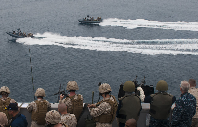 Sailors and Marines aboard USS New Orleans (LPD 18) observe Sailors operating rigid-hull inflatable boats