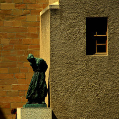 Kindred spirits (Arni J.M.) Tags: building window statue architecture geotagged switzerland shadows geneva head pensive walls geotag genève nikond80
