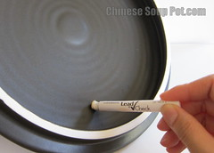 [photo-rub lead test swab on ceramic clay]