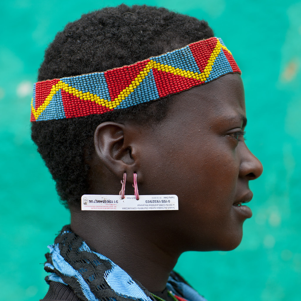New fashion in Bana tribe: scratched sim card as earrings - Ethiopia
