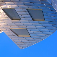 No Way! (Lord Jezzer) Tags: blue sky building window face metal architecture silver mouth pareidolia point eyes niceshot curves sharp noway surprise frankgehry shocked fenestration louruvocenterforbrainhealth humbleofferingofhumbility
