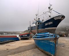 Descanso (cangus) Tags: barcos asturias olympus pesca niebla cudillero zd1122mm e520 puertodecudillero