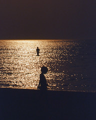 Just a child (vALeRiA MoRRonE sfumatura  Warsaw) Tags: sunset sea mer man film beach kids strand analog 35mm contraluz children mar reflex kid agua nikon eau europa europe tramonto mare child bambini perfil profile playa uomo bimbo mann enfants valeria albania acqua plage spiaggia hombre adriatic controluce analogica homme det adriatico d60 profilo morrone sagoma analogcamera albanie adriatik shqipri plazh uj burr   evrop