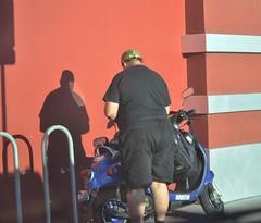(Veee Man) Tags: blue shadow man black wall person back store lasvegas nevada gimp scooter business bikerack fryselectronics vogon nikond5000