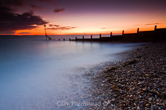Glowing Horizon. (Olly Plumstead) Tags: light sunset orange seascape motion ice silhouette misty clouds canon se long exposure sigma blurred filter le 09 he olly 06 1020 groyne hitech plumstead gnd 450d awesomesauce