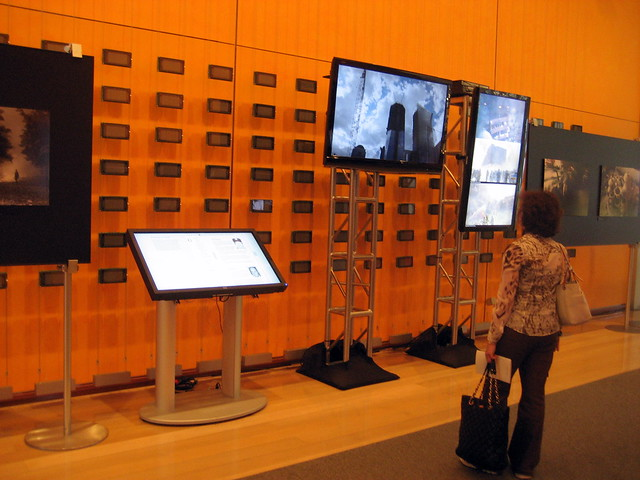 Video screens and an interactive exhibit