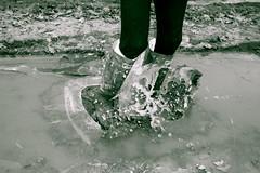 splash (leavingjustintime) Tags: ice puddle crack splash wellies