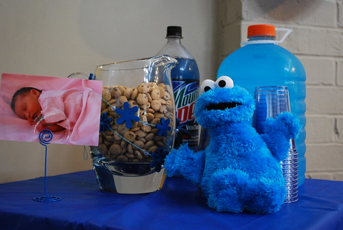 Pitcher of cookies, cups, and blue drinks