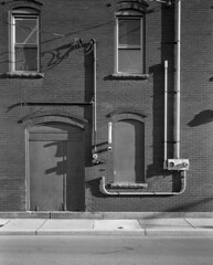 One-A-Day, 7/23/11 Downtown Findlay Apartment (mat4226) Tags: light ohio bw orange film oneaday river diy downtown nw apartment northwest w n wideangle 8x10 filter oh hp5 f56 findlay ilford fujinon largeformat blanchard harsh zonesystem sidelit filmphotography eastmankodak sheetfilm 11100 210mm pyrocathd homeprocessed eastmancommercialb compensatingdeveloper dilutedeveloper believeinfilm